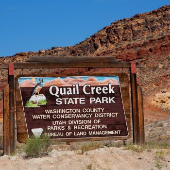 "Signage for Quail Creek State Park near Hurricane, Utah. ""Washington County Water Conservancy District - Utah Division Parks & Recreation - Bureau of Land Management"""